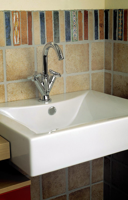 A square basin with a bathroom faucet